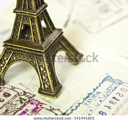 Stamped passport with Eiffel passport - Travel to Paris concept - stock photo