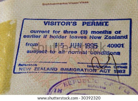 stamped visa in a passport - stock photo