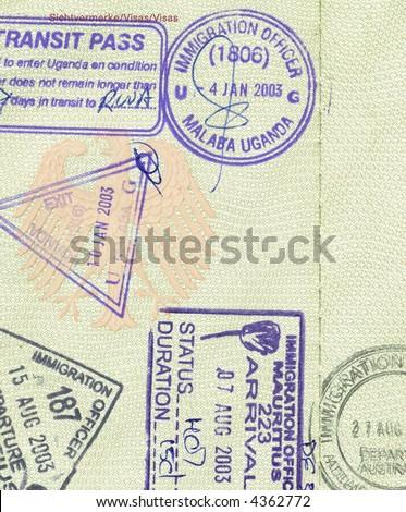 stamps of mauritius, uganda and australia in german passport - stock photo