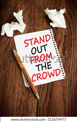 Stand out from the crowd concept. - stock photo