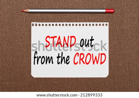 Stand out from the crowd concept. Business message text wording on the note paper  - stock photo
