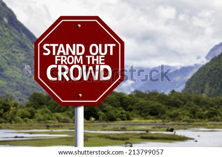 Stand Out From the Crowd red sign with a landscape background - stock photo