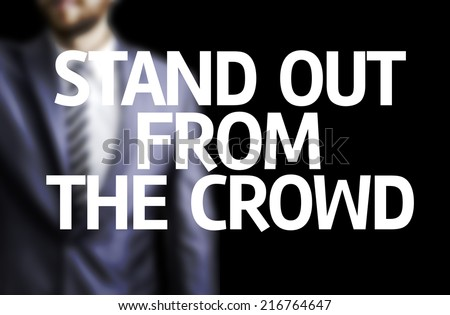 Stand Out From the Crowd written on a board with a business man on background - stock photo
