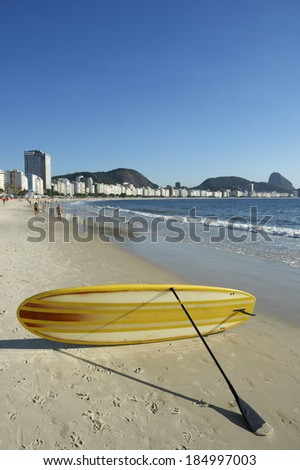 Stand up paddle long board surfboard on Copacabana Beach Rio de Janeiro Brazil - stock photo