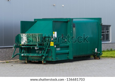 standalone container for compressing waste from factory - stock photo