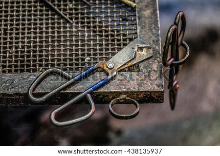 Standard Blowing Glass Diamond Shear Scissors on a Metal Table - stock photo