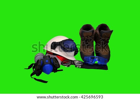 Standard construction safety concept , safety glasses ,Safety shoes ,Chemical masks , construction plans protective gloves hard hat earmuffs for construction site on green sceen for your work . - stock photo