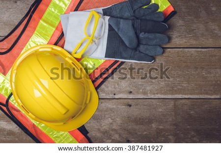 Standard construction safety equipment  on wooden table. top view - stock photo