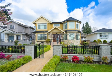 Standard house with long doorway in a residential neighborhood. Vancouver Canada. - stock photo