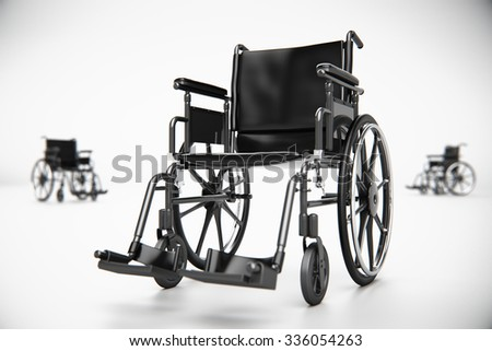 Standard manual wheelchair standing in white empty room - stock photo