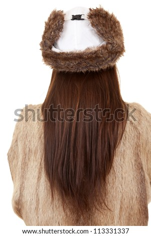 standing back long hair woman in fur coat and hat, white background - stock photo