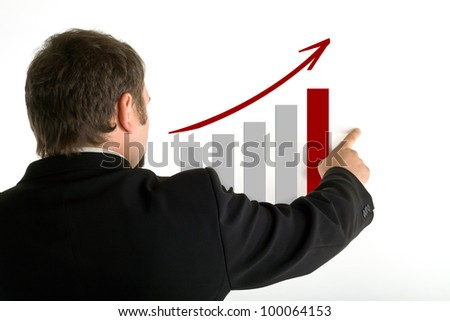 Standing behind a man shows his index finger on growth graph, white background - stock photo