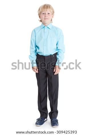 Standing blond boy wearing blue shirt looking at camera, full length, isolated on white background - stock photo