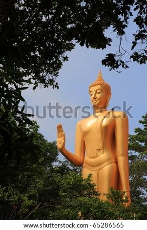 standing bronze statue Buddha, image - stock photo