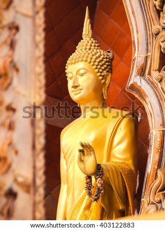 Standing Buddha status . Buddha image style pagoda. - stock photo