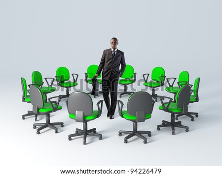 standing business man and green chair - stock photo