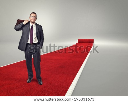 standing businessman on red carpet - stock photo