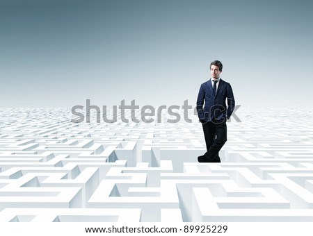 standing caucasian man in 3d maze - stock photo