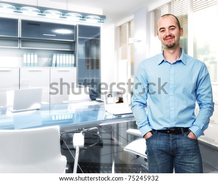 standing confident man in 3d modern office - stock photo