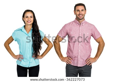 Standing couple posing for camera on white screen - stock photo