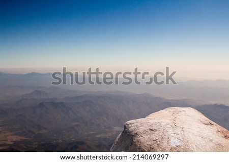 Standing empty on top of a mountain view - stock photo