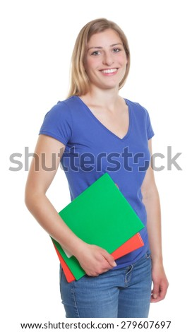 Standing german student in a blue shirt looking at camera - stock photo