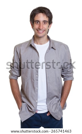 Standing guy in a grey shirt and jeans - stock photo