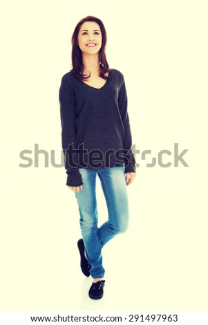 Standing happy woman looking up - stock photo