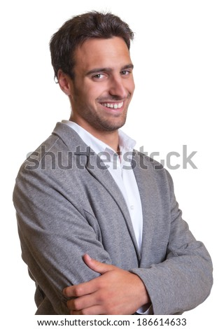 Standing latin businessman in grey suite with crossed arms  - stock photo