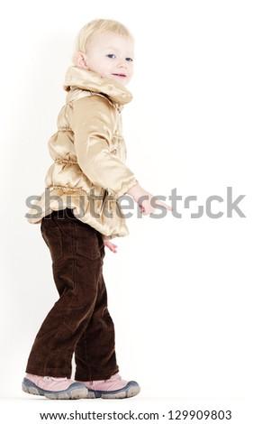 standing little girl wearing jacket - stock photo