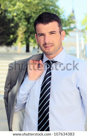 standing man waiting outdoor in summer - stock photo