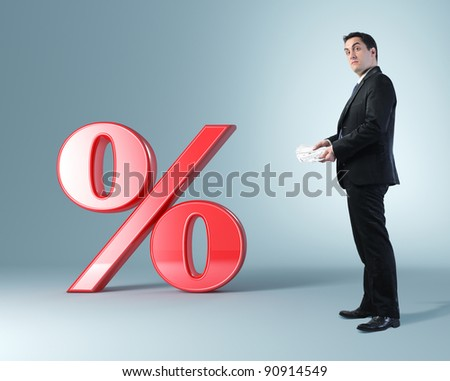 standing man with money and red 3d percent - stock photo