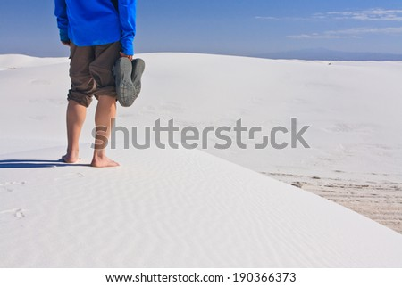 Standing on a sand dune in White Sands National Monument, New Mexico, USA  - stock photo