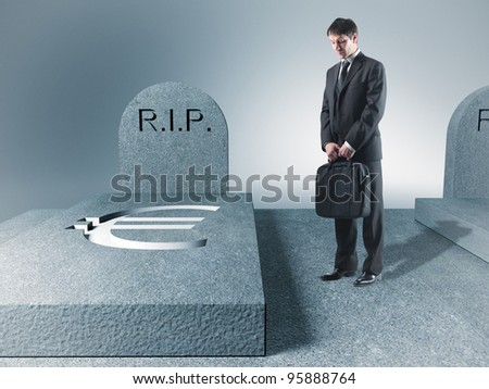 standing sad man and euro tomb - stock photo