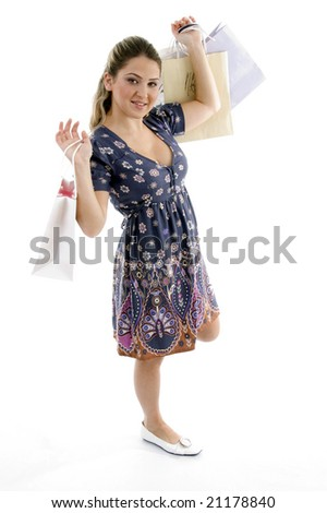 standing woman holding shopping bags with white background - stock photo