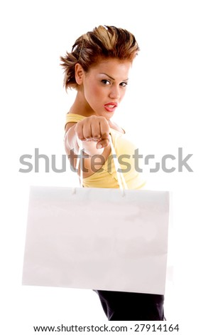 standing woman showing shopping bag with white background - stock photo