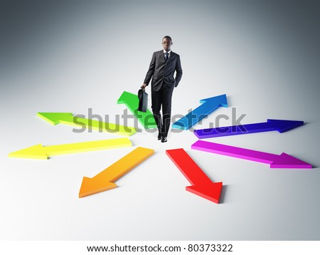 standing young businessman and colorful 3d arrows - stock photo