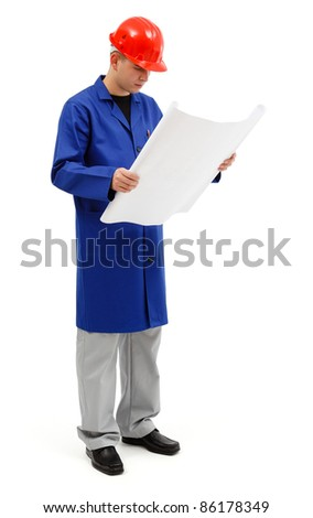 Standing young engineer holding and looking seriously at project plans - stock photo