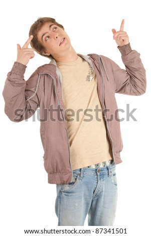 standing young man in casual jacket pointing up - stock photo