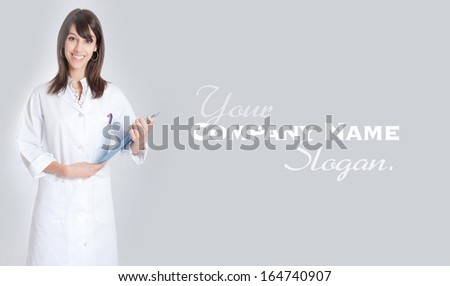 Standing young medical worker holding a folder  - stock photo