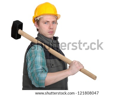 Standoffish tradesman holding a mallet - stock photo