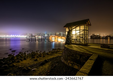 Stanley Park in Vancouver Canada with foggy skyline and firing nine o'clock gun. - stock photo