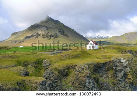 Stapafell mountain in Snaefellsnes Peninsula - Stapafell is a volcanic mountain on the south side of Snaefellsjokull in iceland. This palagonitic pyramide is 526 m in height. - stock photo