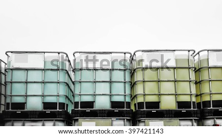 Staple of chemical container with metal cases - stock photo