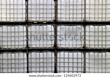 Stapled IBC container in a chemical warehouse - stock photo