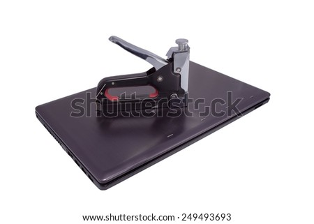 stapler and laptop - stock photo