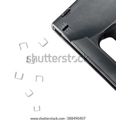 stapler and staples on white background - stock photo