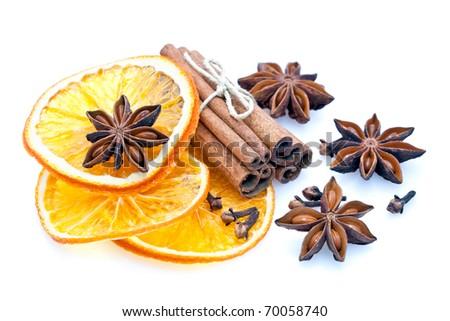 Star Anise, cinnamon sticks, cloves and orange slices for Christmas baking, isolated on white background - stock photo