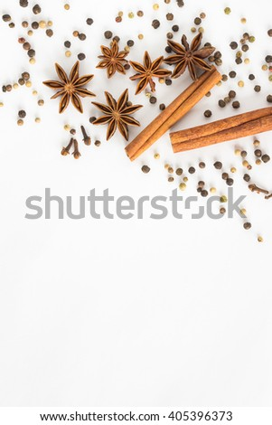 Star anise, cinnamon sticks, cloves and pepper on a white background - stock photo