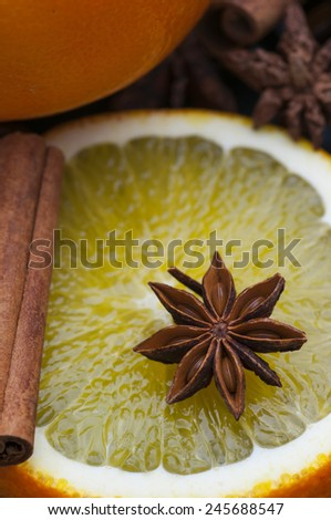 Star anise on fresh orange slice. - stock photo